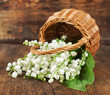 bouquet of lilies of the valley in a wicker basket