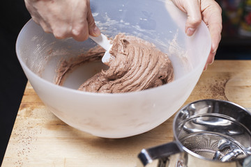 Mixing a batted for a chocolat cake.