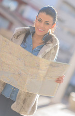 Beautiful Woman Looking In Map