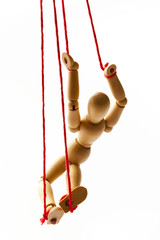 Wooden Figure Hanging in a Red Rope