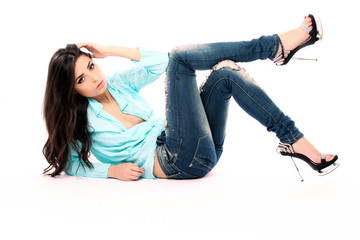 Sensual girl with blue shirt and jeans