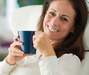 Happy Mature Woman Drinking Coffee