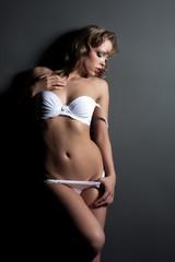 Passionate woman posing in erotic lingerie