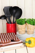 Kitchen settings: utensil, potholders, towels and else