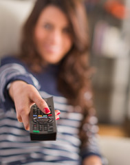 Happy Woman Holding Remote Control