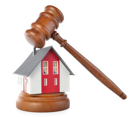 Gavel and house model for subprime loan crisis concept