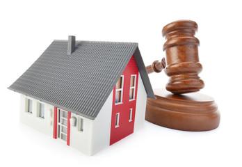 Gavel and house model isolated on white background