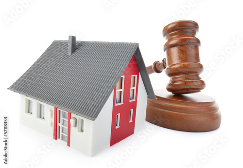 Gavel and house model isolated on white background