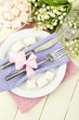 Table setting in violet and pink tones