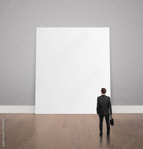 man looking at poster