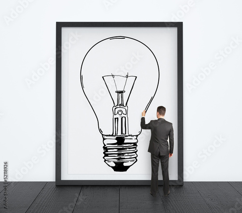 man drawing lamp