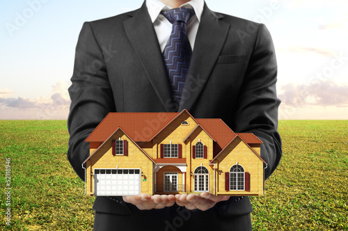 man holding house