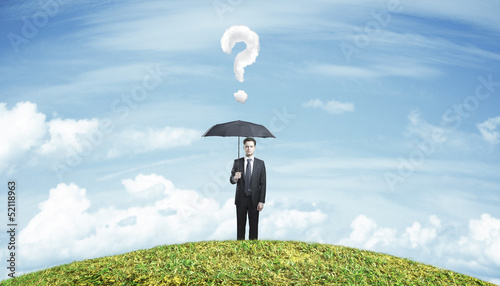 man standing with umbrella
