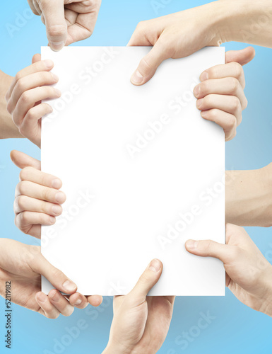 many hands holding poster