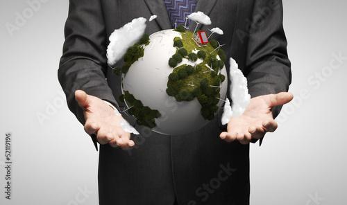 men holding earth
