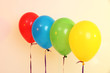 Four bright balloons on light background