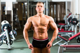 Bodybuilder posing in Gym