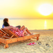 Couple in hug watching together sunrise over Red Sea in Egypt