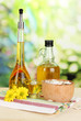 Useful pumpkin seed oil on wooden table on natural background