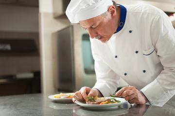 Chef garnishing a dish