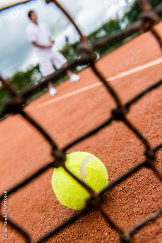 Tennis player playing a match