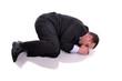 businessman in fetal position