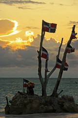 Dominican flags at sunrise on Bavaro beach, Dominican Republic