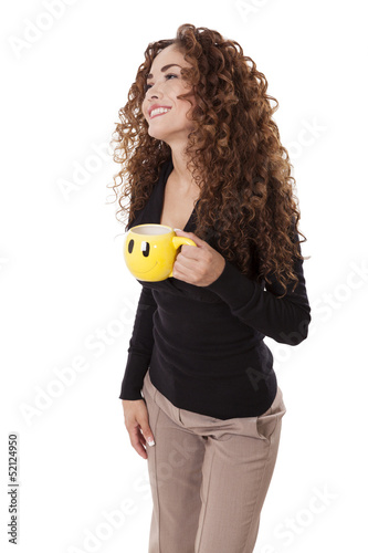 Woman laughs while holding a coffee cup with a smiley face on it