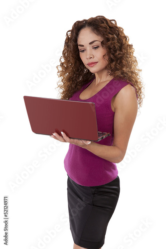 Woman standing with a laptop computer in her hands.