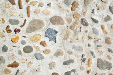 Various stones embedded in concrete