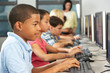 Elementary Students Working At Computers In Classroom