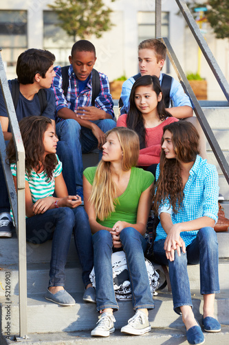 Group Of Teenage Pupils Outside Classroom