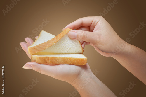 hand holding two slices of bread