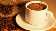 cup of coffee on a background . Spoon coffee mixes