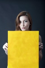young woman with canvas panel for advertising and text