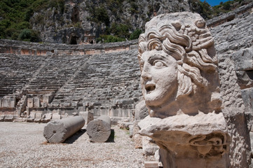 Stone mask and ancient amphitheater, Myra (Turkey )
