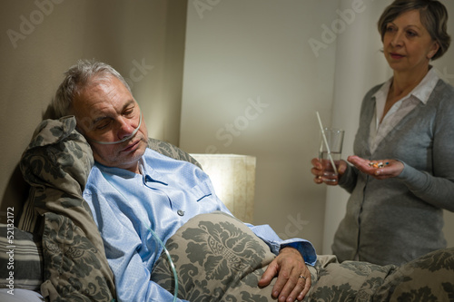 Ill old male patient and caring wife