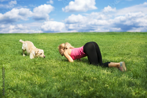 woman playing with a dog at the park