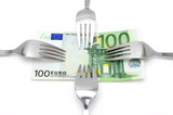 concept of tight budget with banknote and fork