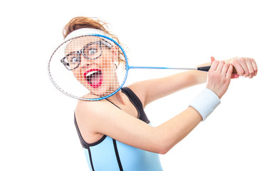 Surprised funny fit woman playing with recket