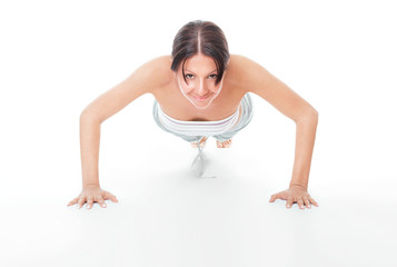 Young woman doing push ups exercise