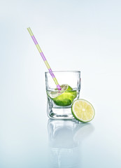Vodka with lemon - lime and drinking straw