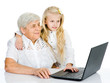 young girl and old woman look in the monitor. isolated