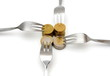concept of tight budget with coins and fork