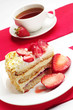 Strawberry cake and cup of tea