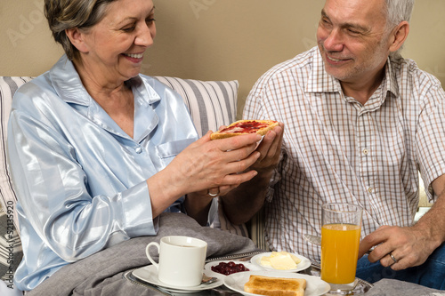 Senior couple having romantic morning breakfast