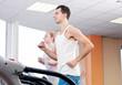 Man at the gym exercising. Run.