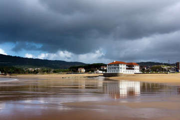plentzia beach with stormy weather and reflections