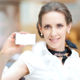 Business woman showing her blank business card