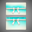 gift cards with white bows and ribbons